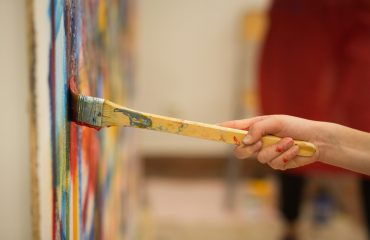 Closeup,Of,The,Hand,Of,A,Child,Painting,A,Mural