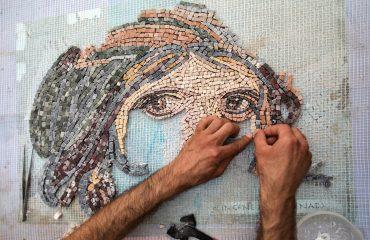 Man,Making,Mosaic